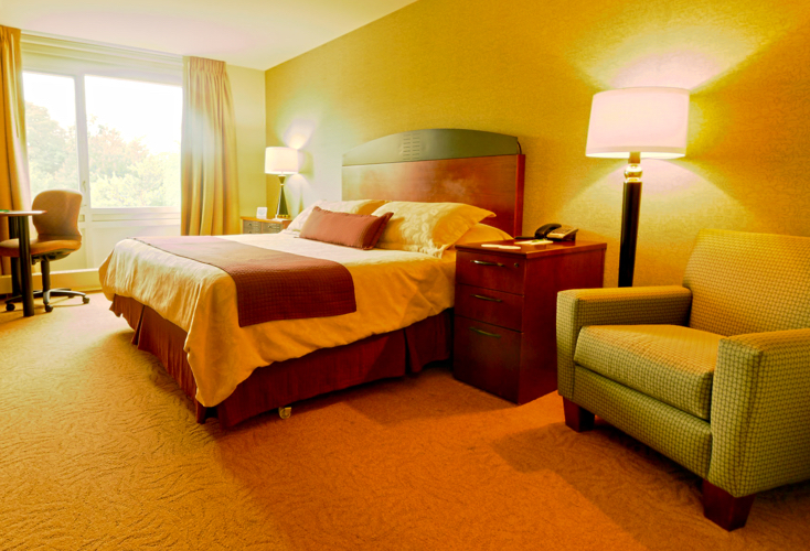 hotel room with king bed and chair