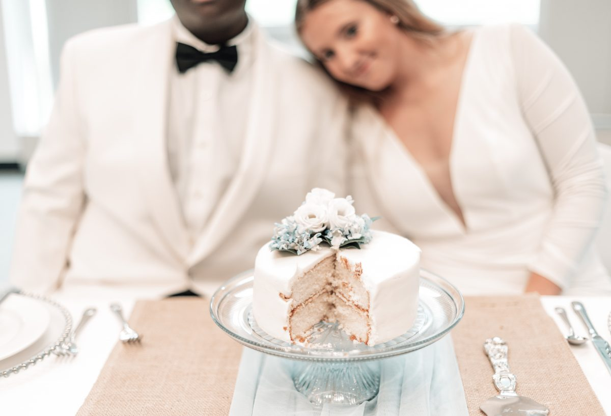 couple smiling with cake