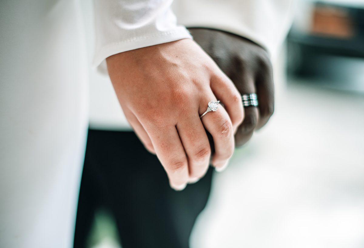 couple wedding rings close