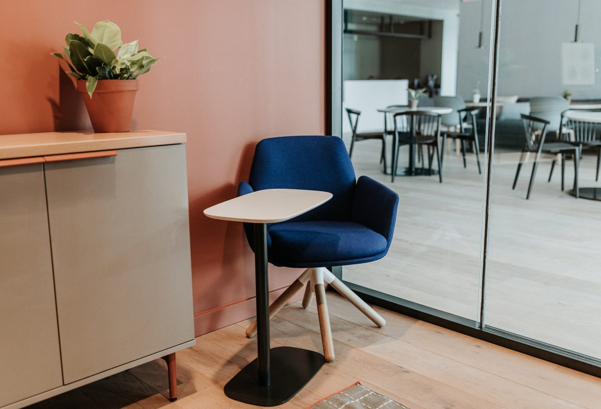 modern blue chair with wooden legs